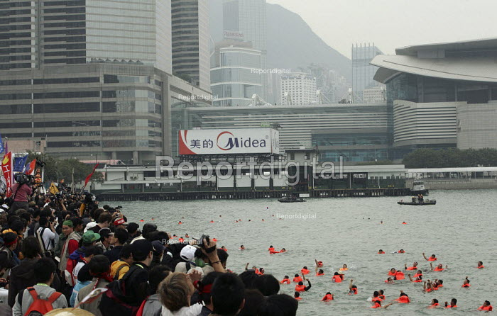 Korean farmers hold a protest in the water surrounding the convention centre. Demonstrations on the opening day of the WTO Ministerial Meeting in Hong Kong. - Jess Hurd - 2005-12-13