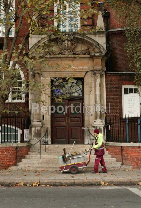 Road sweeper walks past the Working Mens College. London. - Jess Hurd - 2005-11-25