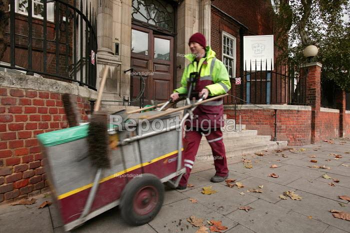 Road sweeper walks past the Working Mens College. London. - Jess Hurd - 2006-01-13