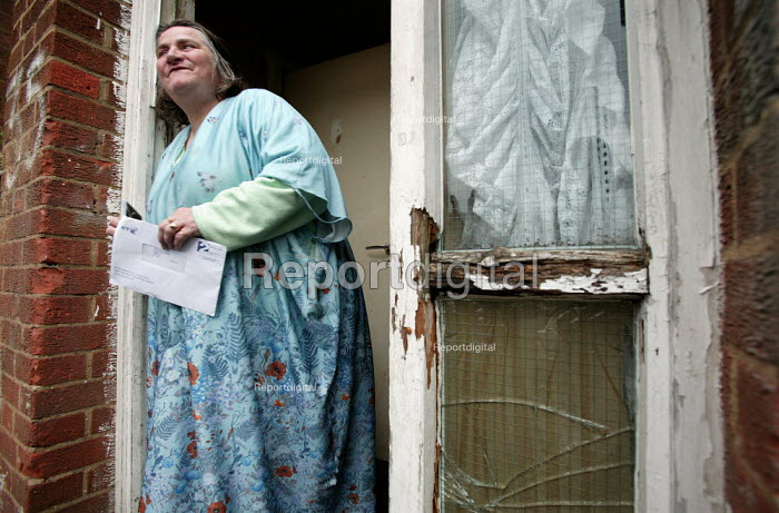 Marilyn Boyle who has been waiting for council repairs for twenty years. She has heart problems, her husband has emphysema and they live in a house riddled with woodworm which has rotted the flooring and damp which is visible throughout. Bow, Tower Hamlets, East London. - Jess Hurd - 2006-04-20