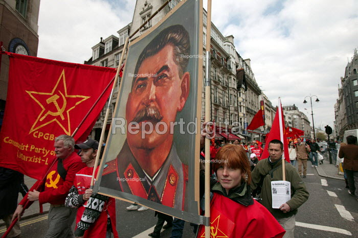 The Communist Party with an image of Joseph Stalin walk down the Strand. International Workers Day May Day march, London. - Jess Hurd - 2006-05-01