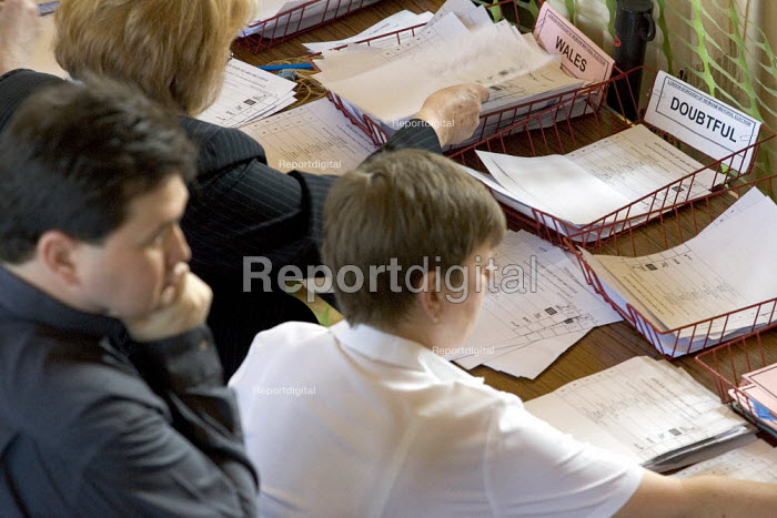 Council workers sort ballot forms at the Newham English local election count. East London. - Jess Hurd - 2006-05-05