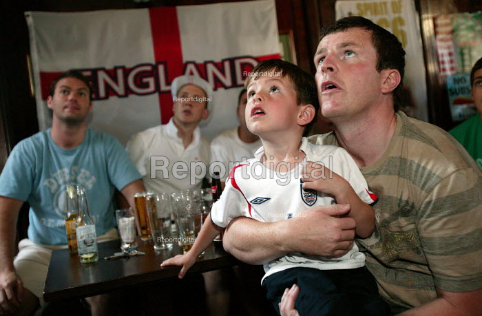 Football fans watching England lose to Portugal in the World Cup quarterfinal in an East End pub, London - Jess Hurd - 2006-07-01