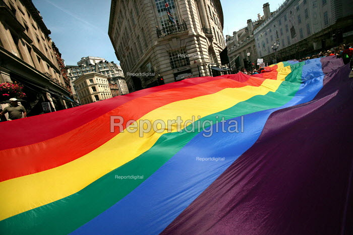 A giant Freedom flag is carried down Regent Street for the first EuroPride Parade, London. - Jess Hurd - 2006-07-01