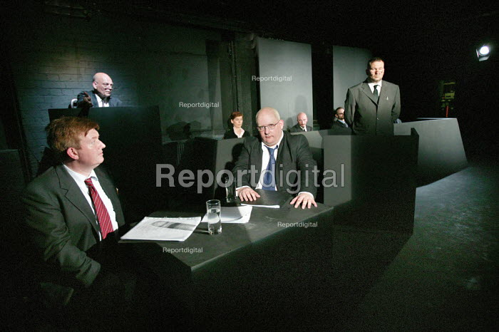 Simon Magorian (left) Grant Holdsworth (right,foreground) defence and prosecution in the play The Investigation a dramatic reconstruction of the Frankfurt War Crimes trials, based on the actual evidence given. The testimony, concerning Auschwitz and the atrocities which were enacted there, have been edited and extracted by Peter Weiss into a dramatic document that relies solely and completely on the facts for its effectiveness. Almeida Theatre, London. - Jess Hurd - 2006-06-29
