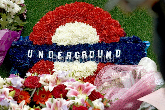 One year on - floral tribute from London Underground workers at Russell Square tube station for the victims of the London Bombings. Kings Cross, London. - Jess Hurd - 2006-07-07