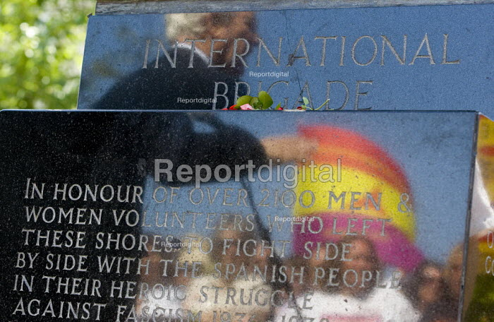 Rodney Bikerstaffe is reflected in the memorial plaque speaking to International Brigade veterans on the 70th anniversary at the annual commemoration of the Spanish Civil War. London. - Jess Hurd - 2006-07-15