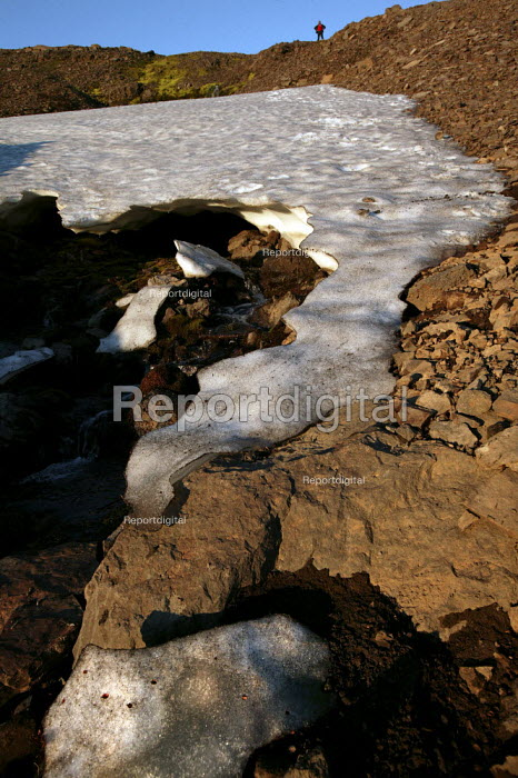 Melting glacial ice in the form of a question mark. Snaefell Mountain. Iceland. - Jess Hurd - 2006-07-23