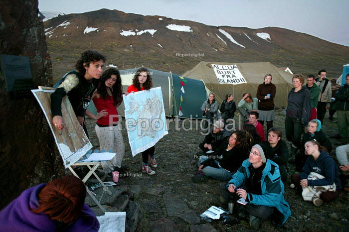 Planning meetings at the Friends of Iceland, Saving Iceland protest camp at Snaefell Mountain. The camp is highlighting the environmental concerns about a dam project at Karahnjukar. Icelands hydroelectric potential is being expoloited by multinational corporations and the dams are designated solely to generate energy for a massive ALCOA aluminium smelter to be built by Bechtel in the beautiful fjord of Reydarfjordur, East Iceland. - Jess Hurd - 2006-07-24