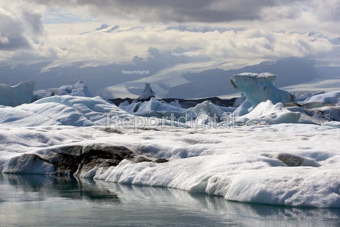 The rapidly expanding Jokulsar Lagoon with icebergs created from the retreating Breidamerkurjokull glacier which is an outlet glacier of Vatnajokull, the largest ice cap in Europe. Iceland. - Jess Hurd - 2006-07-22