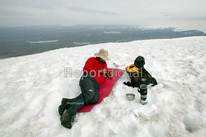Climber uses his GPS on top of Snaefell Mountain. Iceland. - Jess Hurd - 2006-07-23