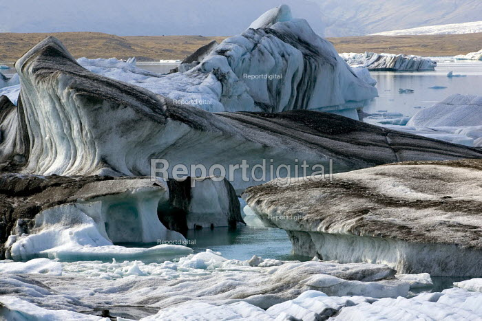 The rapidly expanding Jokulsar Lagoon with icebergs created from the retreating Breioamerkurjokull glacier which is an outlet glacier of Vatnajokull, the largest ice cap in Europe. Iceland. - Jess Hurd - 2006-07-22