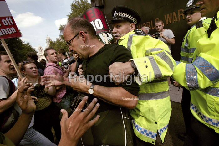 Paul Vicente freelance photographer working for the Times newspaper is arrested by police on a demonstration against Israels bombardment of the Lebanon and Gaza. Protest called for an unconditional ceasefire. Whitehall, London. - Jess Hurd - 2006-08-05