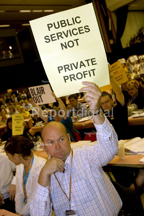 Delegates hold placards in an anti war and anti privatisation protest as Prime Minister Tony Blair addresses TUC Congress 2006, Brighton. - Jess Hurd - 2006-09-12