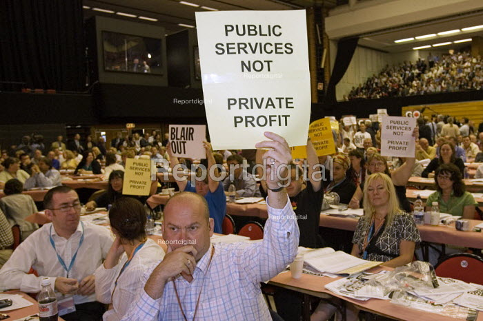 Delegates hold placards in an anti war and anti privatisation protest as Prime Minister Tony Blair addresses addresses TUC Congress 2006, Brighton. - Jess Hurd - 2006-09-12