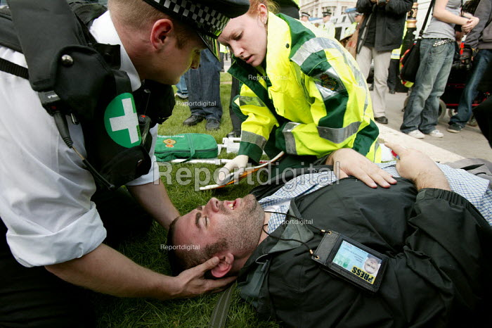 Marc Vallee lies injured on the ground after the police forcibly cleared the road during a Sack Parliament demonstration on the opening of Parliament. Westminster, London. - Jess Hurd - 2006-10-09