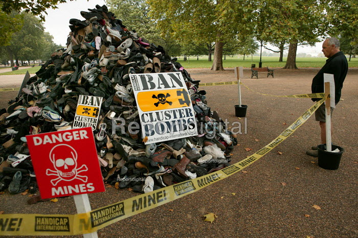 Handicap International UK urges support for victims of cluster bombs in Southern Lebanon and across the world by supporting the campaign to Ban Cluster Bombs. A pyramid of shoes represent the many killed and maimed by the use of cluster bombs. London. - Jess Hurd - 2006-10-14