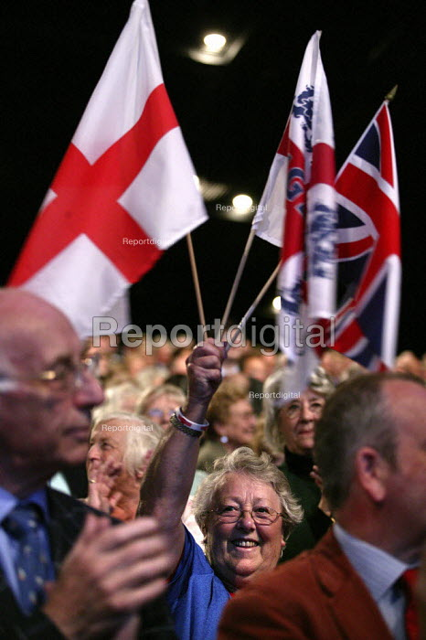 Delegate waves an England flag as David Cameron party leader addresses Conservative Party Conference 2006 - Jess Hurd - 2006-10-04