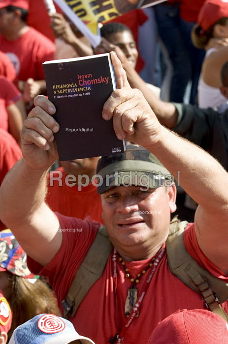 Hugo Chavez supporters with Noam Chomskys book, a critique of US policy called Hegemony or Survival Americas Quest for Global Dominance. Rally in Caracas at the close of the Presidential campaign. Caracas, Bolivarian Republic of Venezuela. - Jess Hurd - 2006-11-26