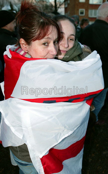BNP supporters wrap themselves in an England flag at rally in Dagenham. East London. - Jess Hurd - 2006-12-09