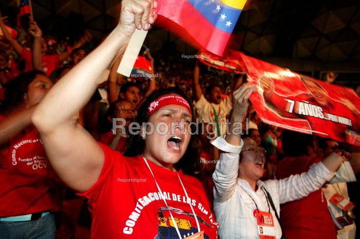 Supporters of President Hugo Chavez appaud him in a stadium where he spoke at the World Social Forum. Caracas, Bolivarian Republic of Venezuela. - Jess Hurd - 2006-01-28