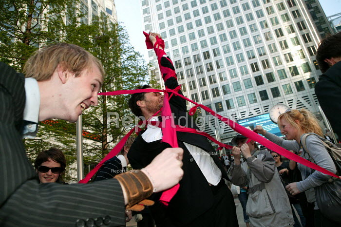 May day Spacehijakers get suited and party at Canary Wharf,. Dancing round a human Maypole, London Docklands - Jess Hurd - 2007-05-01