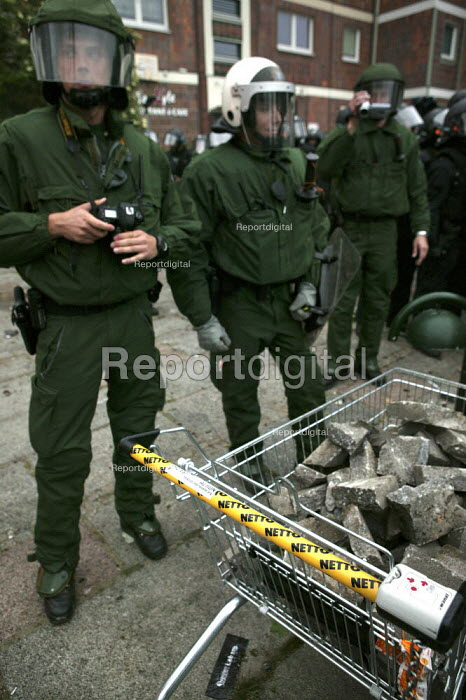 Police with a Netto shopping trolley full of stones. Protests at the G8 summit in Heiligendamm, Rostock, Germany. - Jess Hurd - 2007-06-02