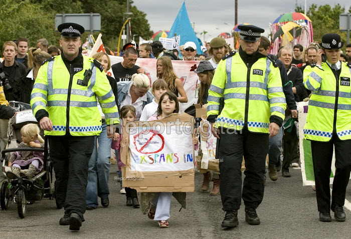Childrens March joins 24hrs of mass action at Camp for Climate Action at Heathrow, the world's busiest airport and a big source of CO2 emissions. London. - Jess Hurd - 2007-08-19
