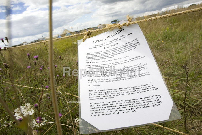 Legal notice on a Climate Camp fence. Camp for Climate Action at Heathrow, the world's busiest airport and a big source of CO2 emissions. London. - Jess Hurd - 2007-08-13