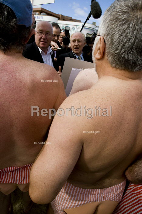 Ex employees from Dexion hold a naked protest about their robbed pensions outside the Labour Party Conference, Bournemouth 2007. Neil Kinnock is lobbied - Jess Hurd - 2007-09-25