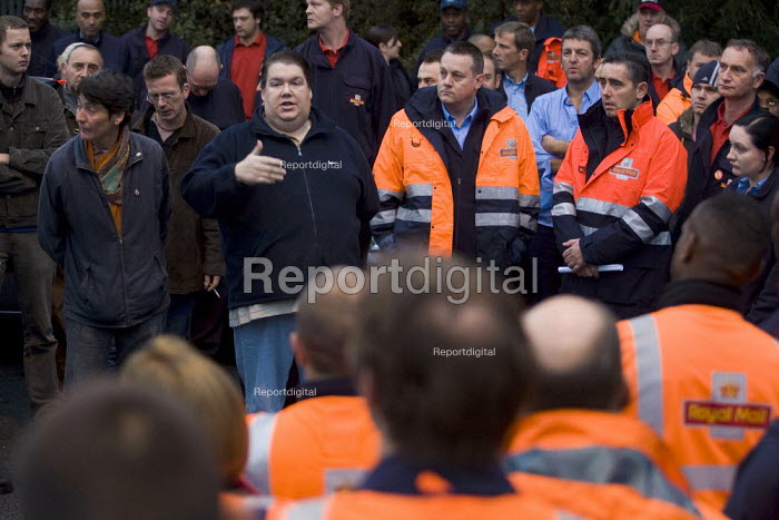Union reps address a mass meeting of CWU postal workers taking unofficial strike action over start times in a general dispute over, pay, pensions and job losses. East London Royal Mail Distribution Centre, Tower Hamlets. London. - Jess Hurd - 2007-10-13