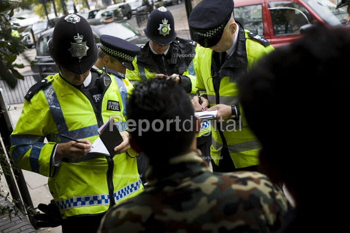 Stop and search of Young Muslim men by police officers as a far-right organisation Stop the Islamisation of Europe holds its first demonstration in London to coincide with the USA Islamo-fascism Awareness week. London. - Jess Hurd - 2007-10-26