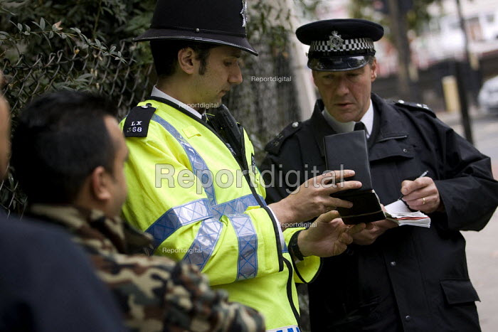 Young Muslim men get stopped and searched by police officers as a far-right organisation Stop the Islamisation of Europe holds its first demonstration in London to coincide with the USA Islamo-fascism Awareness week. London. - Jess Hurd - 2007-10-26