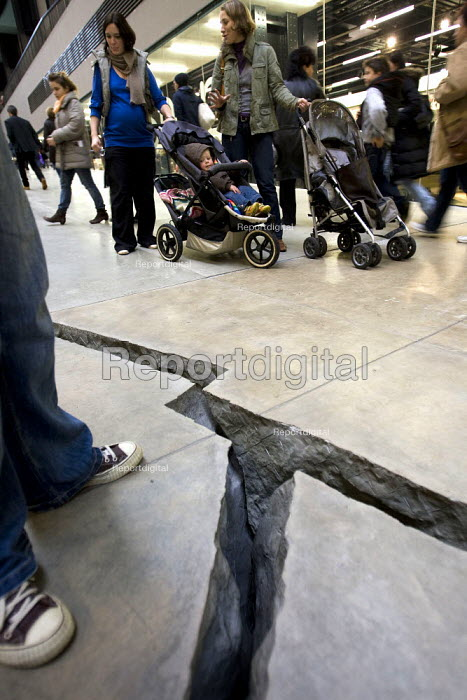 Shibboleth by Doris Salcedo creates a subterranean chasm along the length of Turbine Hall in the Tate Modern. Salcedo addresses a long legacy of racism and colonialism that underlies the modern world. London - Jess Hurd - 2007-10-26