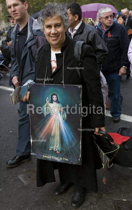 Woman with an image of Jesus Christ the Sacred Heart on an Anti Abortion march, London. - Jess Hurd - 2007-10-27
