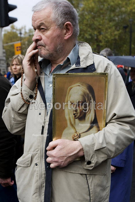 Image of the Virgin Mary crying blood tears on an Anti Abortion march, London. - Jess Hurd - 2007-10-27