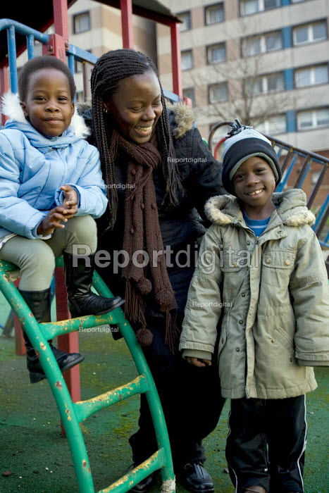 Mary Semirimu, Ugandan asylum seeker with her family who have been granted refugee status. Glasgow, Scotland. - Jess Hurd - 2007-12-29