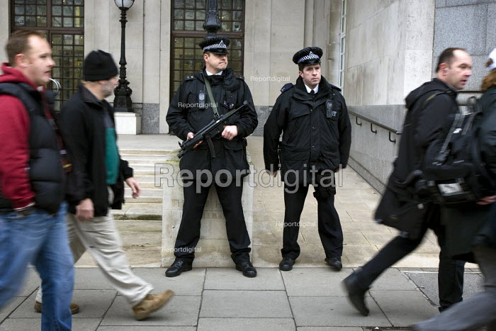 Armed police watch a police protest over pay and for a judicial review of its decision not to backdate officers pay awards. London. - Jess Hurd - 2008-01-23