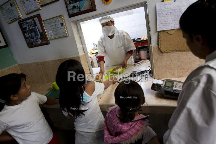 Children have lunch at a community subsidised kitchen. Cuidad Bolivar, South Bogota, Colombia. - Jess Hurd - 2008-02-07