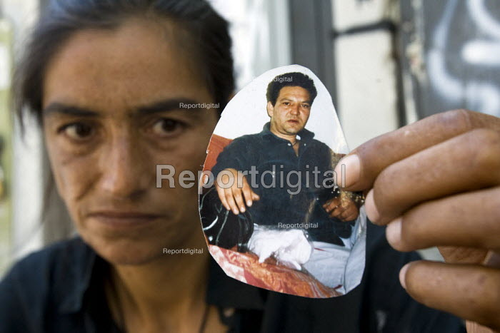 Hasiba, a Bosnian Gypsy who has been outcast from the gypsy community because her now deceased husband (picture Hrustic Avdija) was a drug addict. She is destitute and has had her children taken into care. Rome, Italy. - Jess Hurd - 2008-07-25