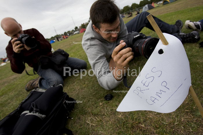 AFP photographers with a Press Camp flag planted as a gesture against the media restrictions at the camp in Blackheath. Climate Camp. South East London. - Jess Hurd - 2009-08-26