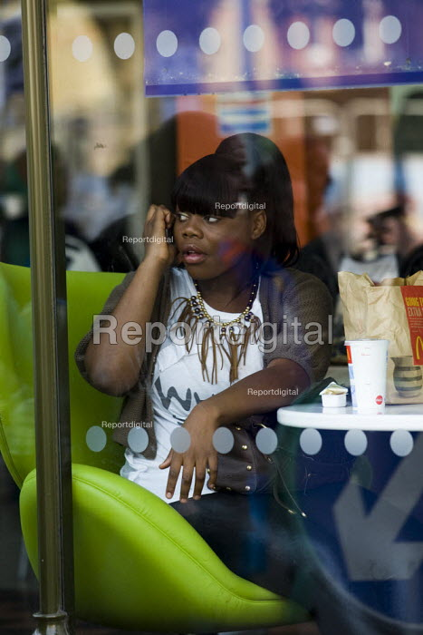 Woman in a McDonald's restaurant. Brixton, South London. - Jess Hurd - 2009-08-21