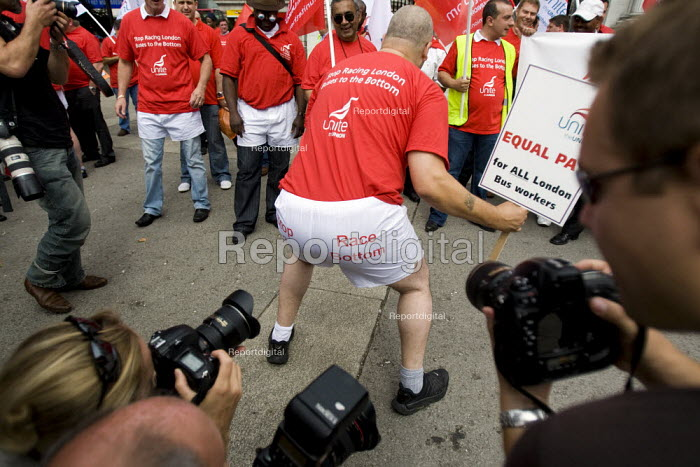 Bus drivers get revealing about pay cuts at London buses. Press photographers taking pictures of underwear protest in central London in call for end of race to the bottom of low pay. Marble Arch, London. - Jess Hurd - 2009-08-05