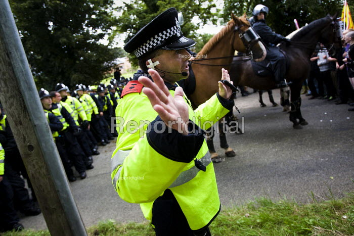 Police Inspector at Unite Against Fascism protest outside the BNP Red White and Blue Festival in Condor, Derbyshire. - Jess Hurd - 2009-08-15