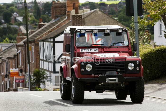 BNP suporters in a Land Rover, Unite Against Fascism protest outside the BNP Red White and Blue Festival in Condor, Derbyshire. - Jess Hurd - 2009-08-15