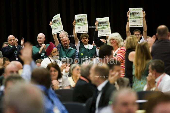 RMT Vestas workers hold up campaign papers as Ed Miliband MP speaks at TUC Conference. They are applauded by members of PCS, NAPO and Bob Crow RMT. Liverpool. - Jess Hurd - 2009-09-16