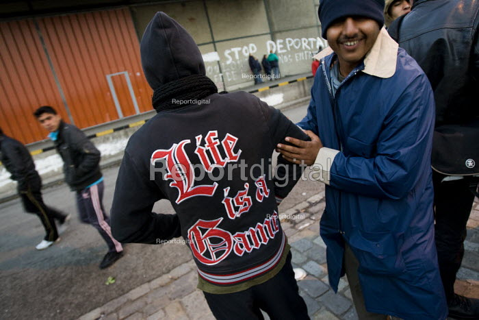 Life is a game. Refugees in Calais made homeless after the clearing of the Jungle. France. - Jess Hurd - 2009-10-16