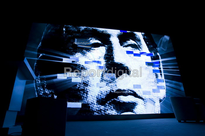 Gordon Brown image being blown apart by blue Tory bricks graphic opens Conservative Party Conference 2009. Manchester. - Jess Hurd - 2009-10-05