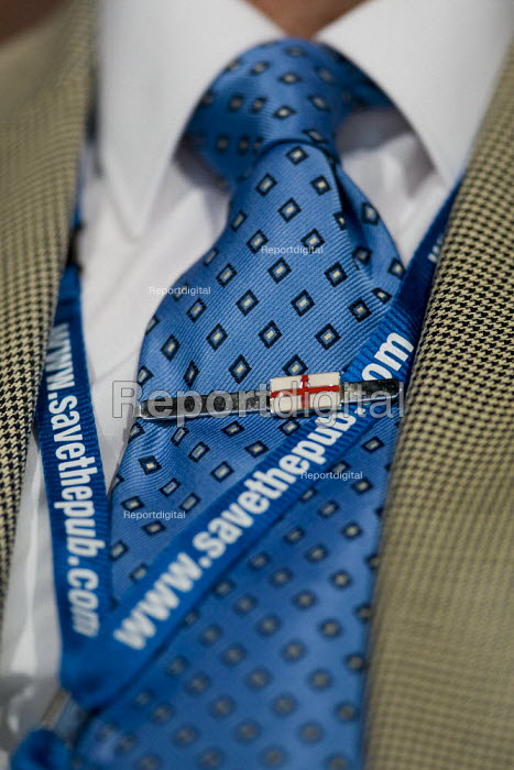 Delegate with England flag badge. Conservative Party Conference 2009. Manchester. - Jess Hurd - 2009-10-06