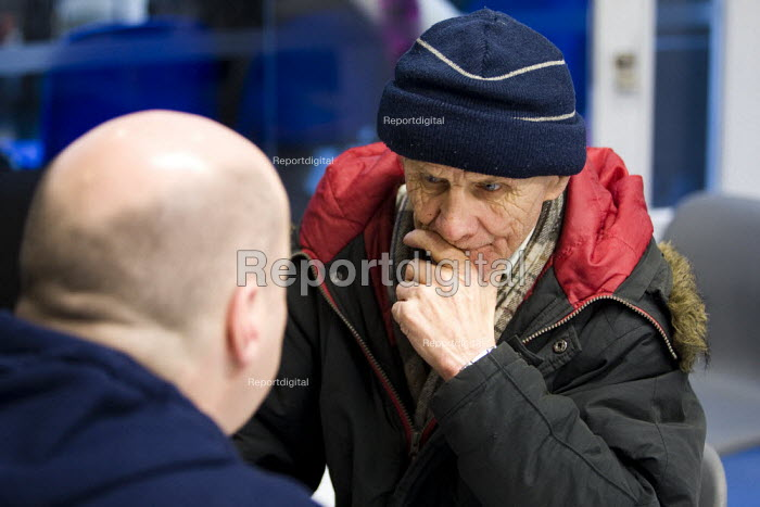 John gets some health advice from a volunteer medic. Crisis day centre opens at Bermondsey City of London Academy. Providing homeless and vulnerably housed people with a range of services, food and shelter. - Jess Hurd - 2009-12-23